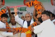 Nitish Kumar being garlanded by supporters in Gaya