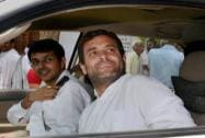 Rahul Gandhi smiles from his vehicle as he visits Amethi on the polling day