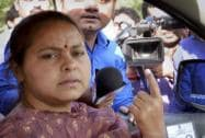 Misa Bharti shows her ink-marked finger