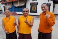Monks show their ink-marked fingers