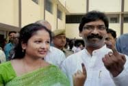 Hemant Soren and his wife show ink marked finger after casting their vote