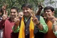 Actor Manoj Tiwari shows victory sign with party members in New Delhi