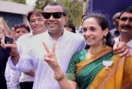 Paresh Rawal along with his wife flashes victory sign ouside a counting centre in Ahmedabad