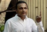 Anil Ambani  showing the ink mark on his finger after casting his vote