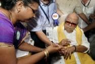M Karunanidhi gets ink mark on his finger before casting his vote