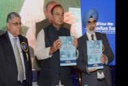 Finance Minister Arun Jaitley releases a publication with G S Sandhu, Financial Services Secretary, and Indian Bank CMD TM Bhasin
