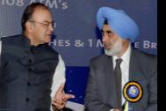 Finance Minister Arun Jaitley talks to G S Sandhu, Financial Services Secretary