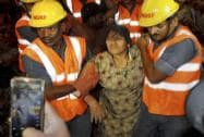 Fire brigade and NDRF personnel rescue a woman