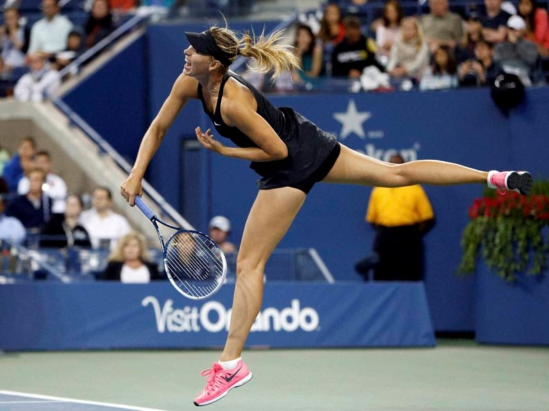 Maria Sharapova, Russia, serves, Sabine Lisicki, Germany,  third round, 2014, U.S. Open tennis tournament
