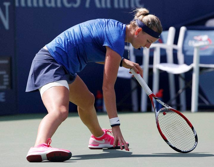 Petra Kvitova, Czech Republic, steadies, off-balance, shot, Aleksandra Krunic, Serbia, third round, 2014, U.S. Open tennis tournament