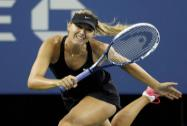 Maria Sharapova of Russia serves to Sabine Lisicki of Germany
