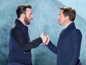 Chris Evans, left, and Robert Downey Jr. play thumb war at the Kids' Choice Awards