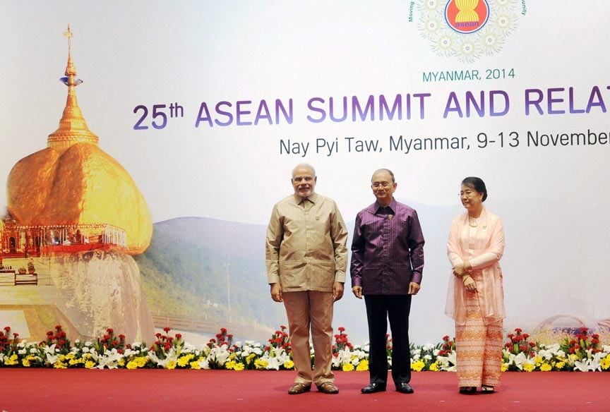 Prime Minister Narendra Modi (L) being welcome by Myanmar President Thein Sein and his wife Khin Khin Win at the Association of Southeast Asian Nations  (ASEAN) and related summits at Myanmar International Convention Center in Naypyitaw, Myanmar