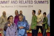 Prime Minister Narendra Modi seen at the back as US President Barack Obama and Chinese Prime Minister Li Keqiang gesture
