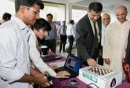 RBI Governor Raghuram Rajan tries his hand at an instrument made by the engineering students