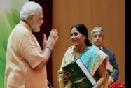Prime Minister Narendra Modi after honouring food processing entrepreneur Krishna Yadav at an award ceremony