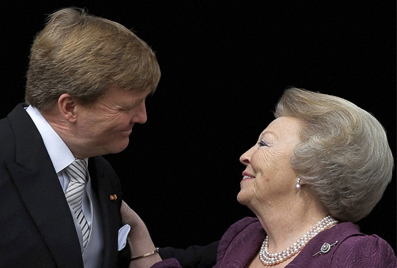 Dutch King Willem-Alexander is greeted by his mother Princess Beatrix on the balcony of the Royal Palace in Amsterda