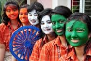 School students paint their faces with tri-colours on the eve of Independence Day