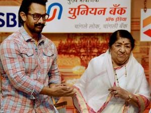 Lata Mangeshkar with Amir Khan during the Master Deenananth  Mangeshkar's 75th death anniversary