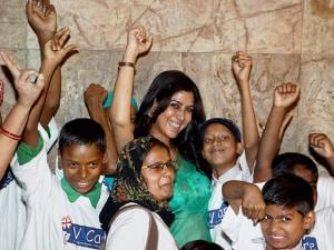 Sakshi Tanwar with children of V Care foundation at the special screening of film Dangal
