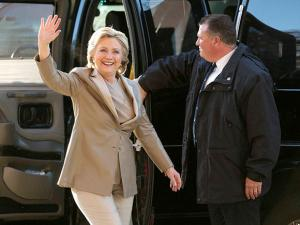 Hillary Clinton waves as she arrives to vote at her polling place in Chappaqua