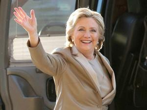 Hillary Clinton waves as she arrives to vote at her polling place in Chappaqua, N.Y.