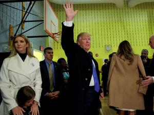 Republican presidential candidate Donald Trump waves after casting his ballot at PS-59