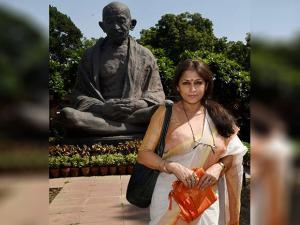 Newly inducted Rajya Sabha member Roopa Ganguly poses infornt of Mahatma Gandhi statue