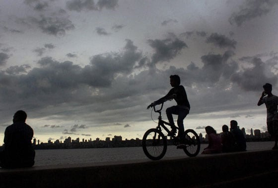 People enjoy the monsoon climate along the Marine Drives in Mumbai on Monday.
