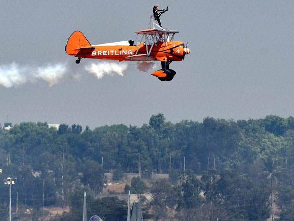 Narendra Modi, Manohar Parrikar, Aero India, Breitling Wingwalkers, UK