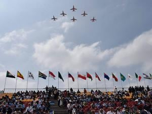 aerobatic team Suryakiran performs during AERO INDIA 2017