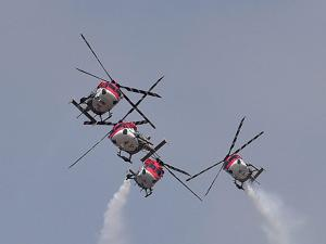 Indian Air Force's aerobatic team Sarang performs during the inauguration of the 11th biennial edition of AERO INDIA 2017