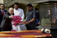 Afghanistan's President Ashraf Ghani showers rose petals to pay tributes at Mahatma Gandhi's memorial, Rajghat