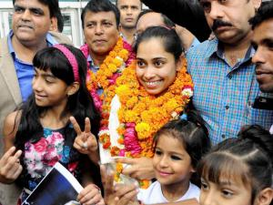 Gymnast Dipa Karmakar is welcomed upon her arrival at IGI airport in New Delhi. Dipa Karmakar has become the first Indian woman gymnast to qualify for Olympics
