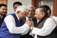 SP chief Mulayam Singh Yadav and RJD chief Lalu Prasad Yadav exchange greetings
