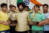 AIATF Chairman MS BItta presents awards to Rakesh Sharma and Vikramjeet
