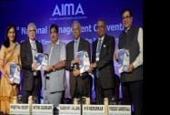 Nitin Gadkari along with AIMA President Preetha Reddy and others releases a publication during the AIMA's 41st National Management Convention