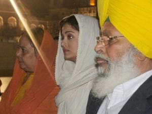 Aishwarya Rai Bachchan gestures during a visit to the Golden temple in Amritsar
