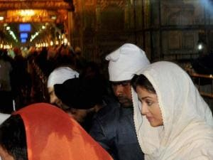 Aishwarya Rai Bachchan gestures during a visit to_the Golden temple in Amritsar