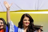 Bollywood actress Aishwarya Rai Bachchan waves as she attends the inauguration of a jewellery showroom
