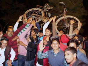 Supporters celebrate in Allahabad after UP Chief Minister Akhilesh Yadav got the Samajwadi Party symbol, the cycle, and the party name