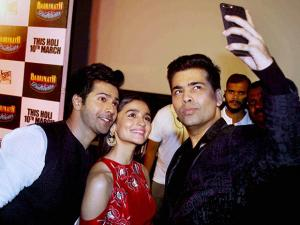 actors Varun Dhawan and Alia Bhatt with filmmaker Karan Johar during the trailer launch of their film Badrinath Ki Dulhaniya in Mumbai