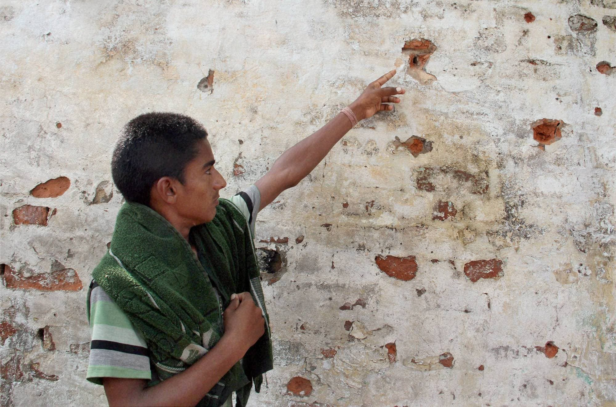 boy shows, bullet, marks, wall, allegedly fired, Pakistan's, Gharna village, India-Pakistan, International border, RS Pura, sector,40 km, Jammu