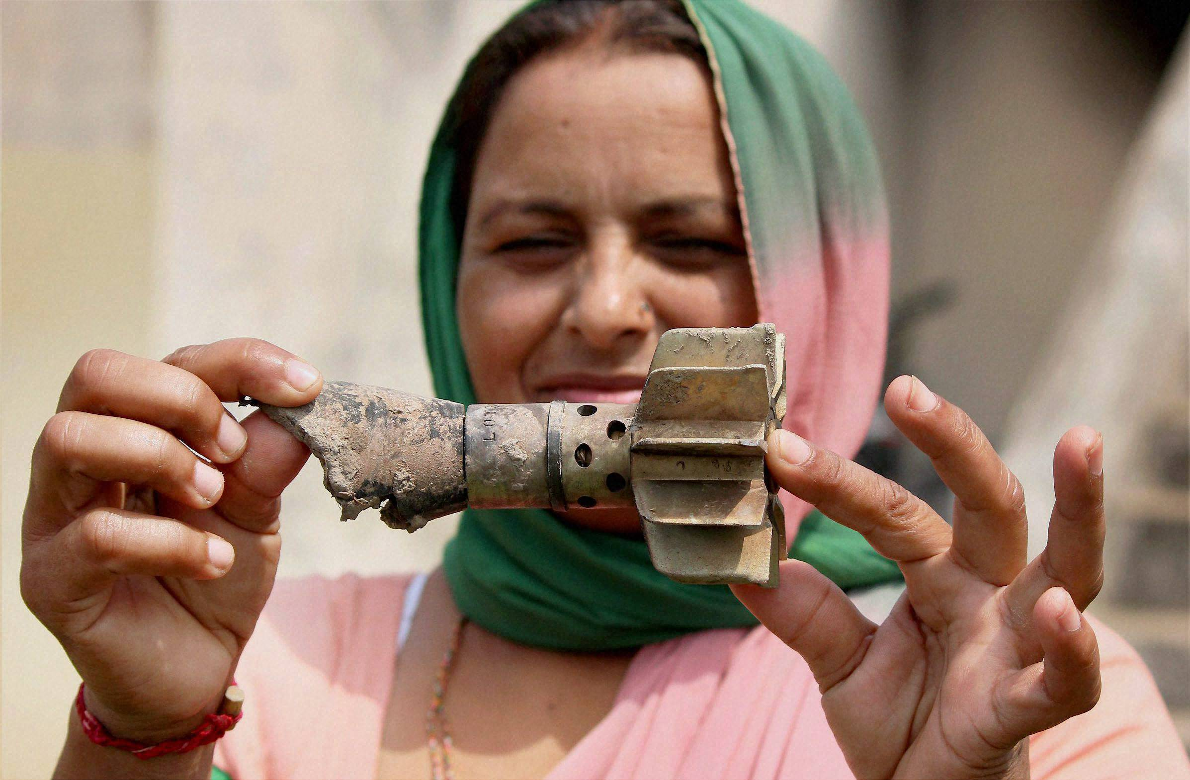 woman, mortar , boy shows, bullet, marks, wall, allegedly fired, Pakistan's, Gharna village, India-Pakistan, International border, RS Pura, sector,40 km, Jammu