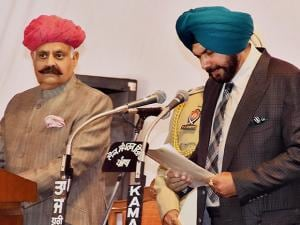 Punjab Governor V P Singh Badnore administering oath to the new Punjab cabinet Minister Navjot Singh Sidhu