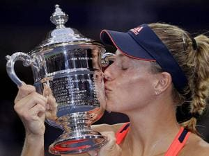 Angelique Kerber, of Germany, kisses the championship trophy