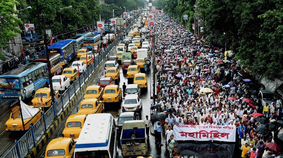 Traffic, stands, still, Left Front activists, take part, rally, observe, Anti-Imperialist Day, Kolkata