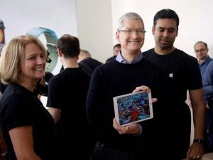 Apple CEO Tim Cook, shows off a new iPad during an event at Apple headquarters