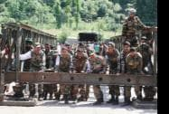 Army Jawans reconstruct a bridge damaged in the flash floods in Poonch
