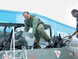 Chief of Air Staff Air Chief Marshal Arup Raha getting down from Light Combat Aircraft (Tejas) after a sortie at HAL Bengaluru